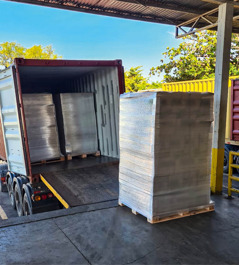 A pallet of relief supplies ready for loading into a shipping container.