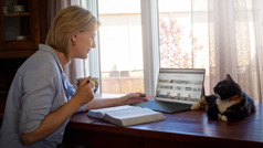 """Geneviève using """"JW Library"""" on her electronic device to do personal Bible study."""